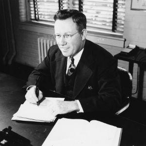 Leonard D. Baver at desk