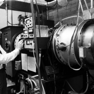 Dr. Wesley Doggett with machinery