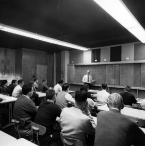 John B. Gaither teaching textiles class