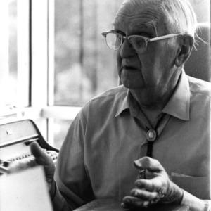 Alvin M. Fountain at desk