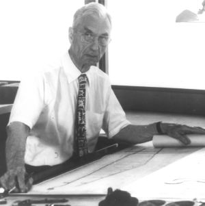 Harwell H. Harris working on architectural drawing