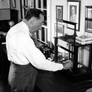 Dr. Clarence W. Hewlett in lab