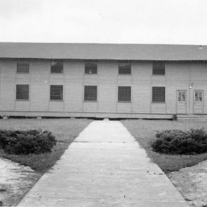 "Front view of temporary classroom building in ""Barracks Square,"" considered a ""Vetville Building"""