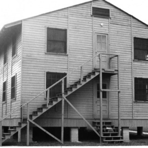 """Side view of temporary classroom building in """"Barracks Square."""""""