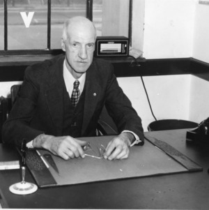 Dean Thomas A. Nelson at desk