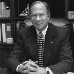 Dean James L. Oblinger at desk