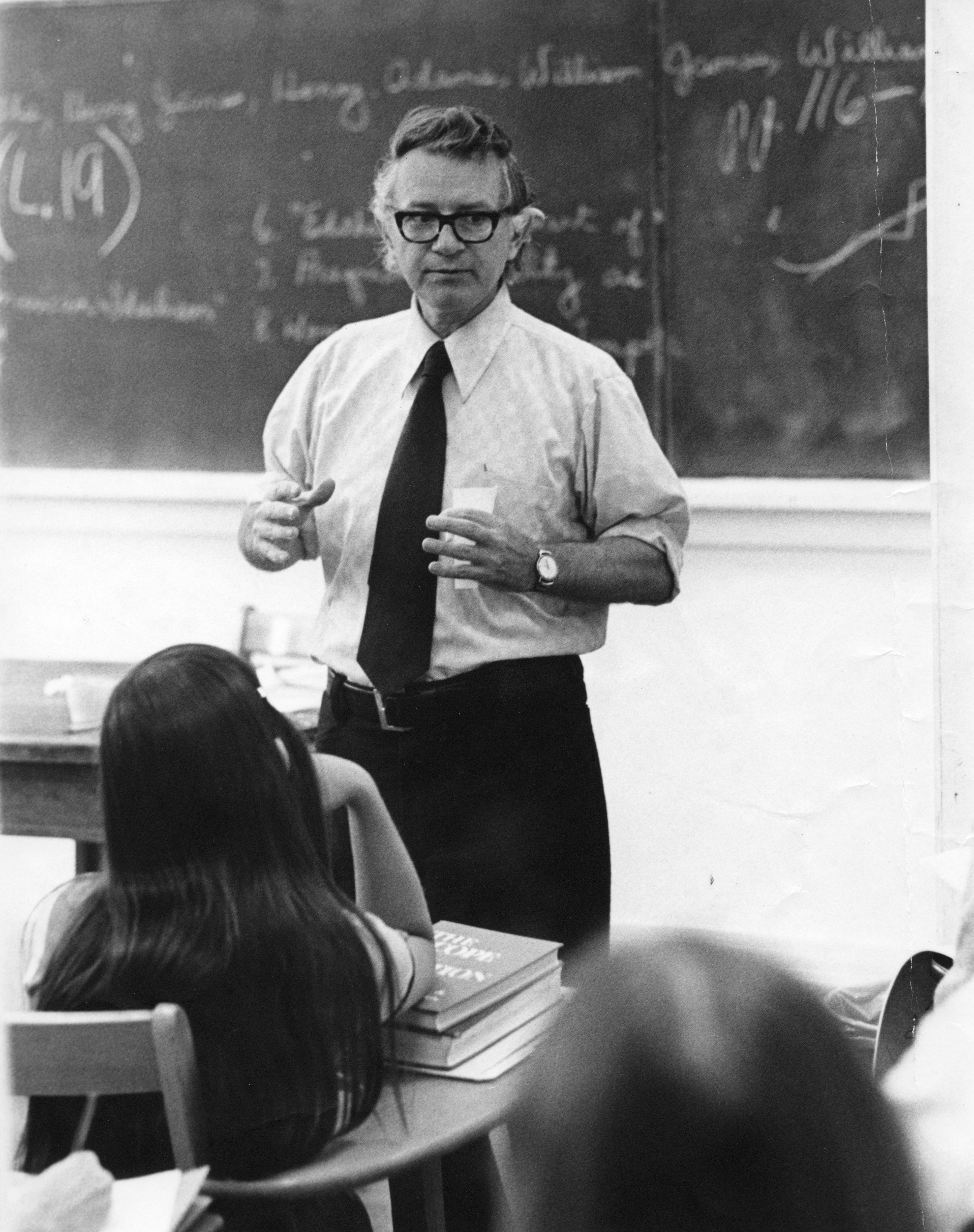 Guy Owen, author and North Carolina State University English professor, standing before a class.