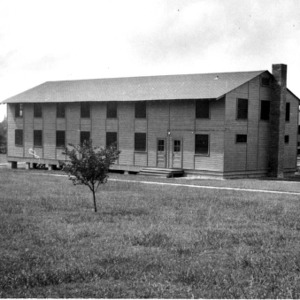 """View of temporary classroom building in """"Barracks Square"""""""