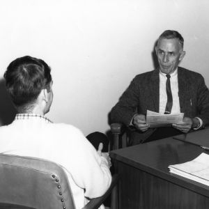 Lyle B. Rogers, Director of Counseling Center, in office with student