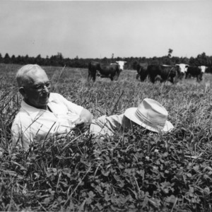 I. O. Schaub relaxing in cow pasture