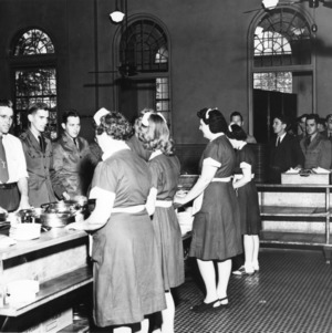 View of the cafeteria line in Leazar Hall showing students and cafeteria employees.