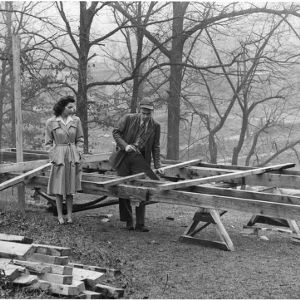 Charles C. Elder and his wife with the framework for the floor of their trailer