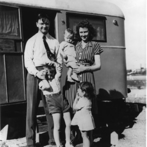 Emmett U. Dillard and his family stand in front of their trailer home on the State College campus in the summer of 1946.