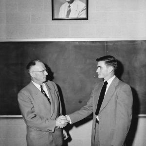 "Alpha Zeta Chapter Room, N.C. State College, dedicated to H. W. [""Pop""] Taylor. Walter Stinson [right], Chancellor of Alpha Zeta, making the presentation."