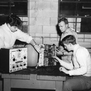 Gaston Technical Institute Students repairing a television set as part of their laboratory work