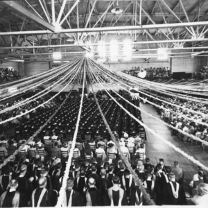 View of graduates and audience at North Carolina State College commencement, 1947.