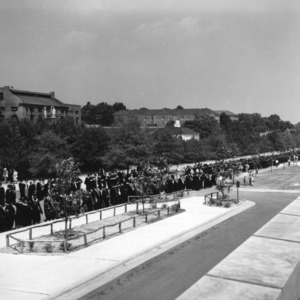 View of graduates lining up outside at North Carolina State College commencement, 1951.