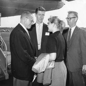 Bennett Cerf at airport, October 1958