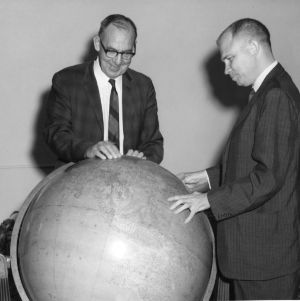 William W. Kriegel and Burton F. Beers looking at globe