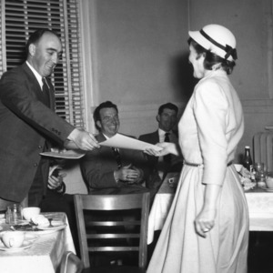 Professor Goode presenting diploma to Mrs. Highsmith, first Beef Production Short Course held at State College from February 21 to March 5, 1949.