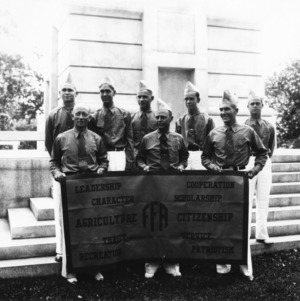 Possibly state officers of the Future Farmers of America posing at Memorial Bell Tower, North Carolina State College during a state meeting on campus.