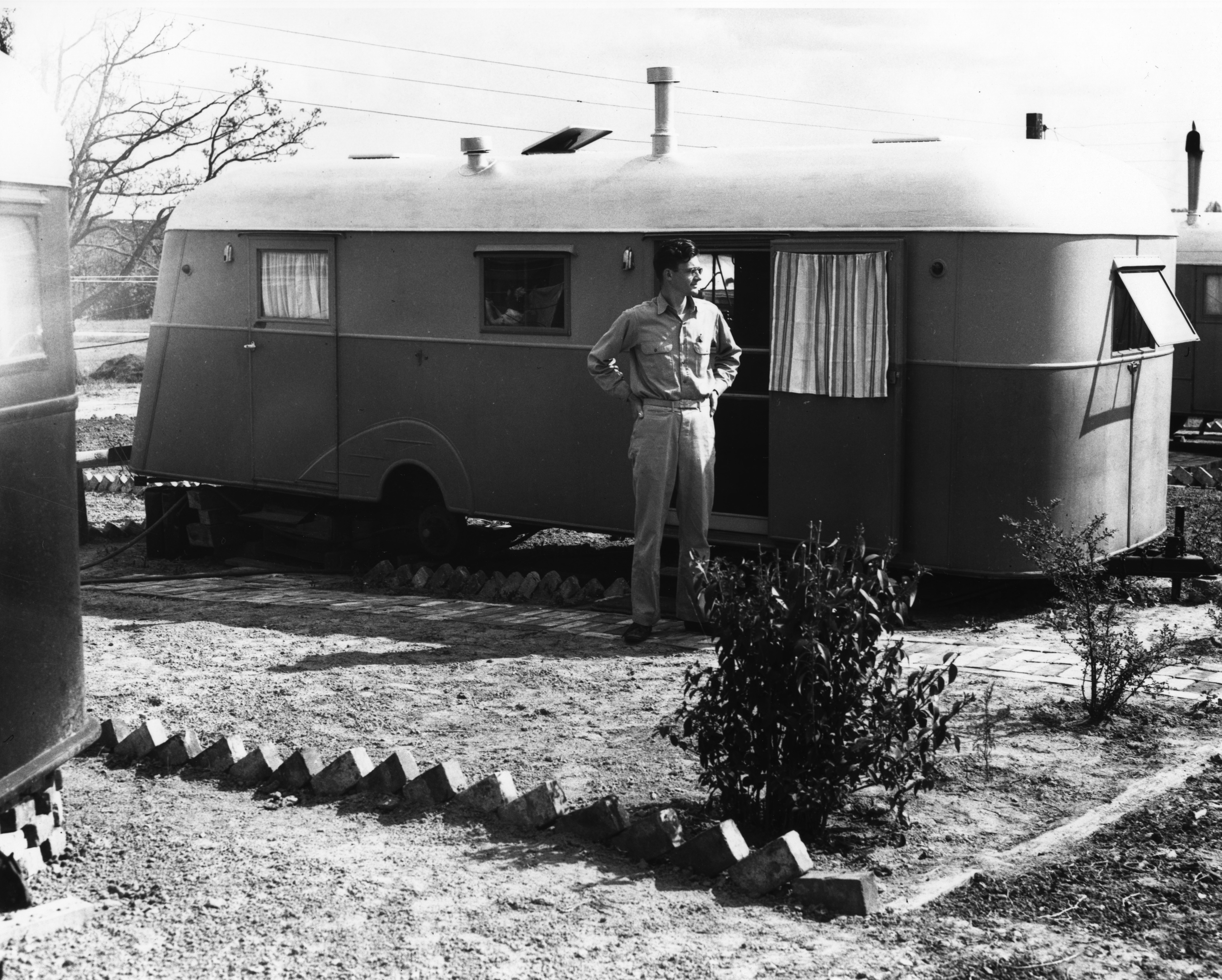 Man Standing In Front Of Trailer Trailwood North Carolina State College March 1946