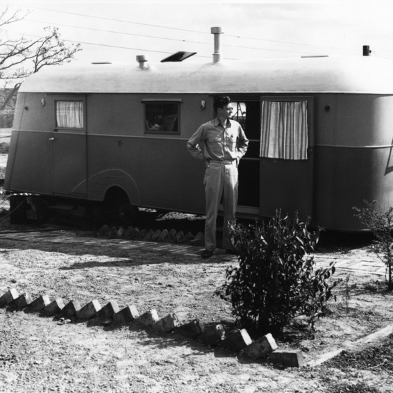 Man standing in front of trailer, Trailwood, North Carolina State College, March 1946.