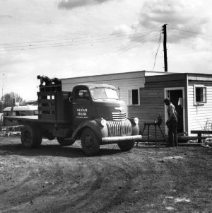 Workers and truck, Trailwood, North Carolina State College, March 1946.