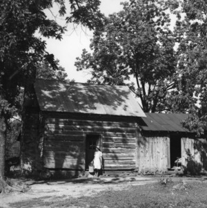 African American woman in front of farm house