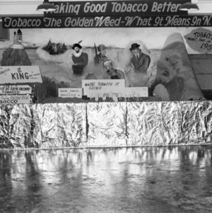 "View of display titled ""Making good tobacco better: Tobacco the golden weed- what it means in N.C"""