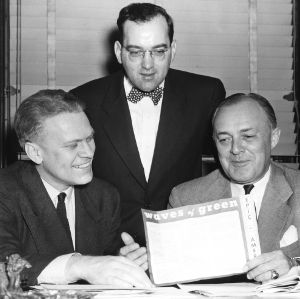 "Congressmen Gerald Ford, Harold D. Cooley, and Walter T. Murphy discussing premiere of the motion picture ""Waves of Green"""