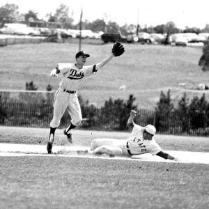 N. C. State baseball player slides onto base