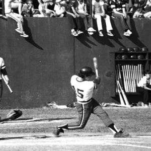 N. C. State baseball player Ron Evans hits home run