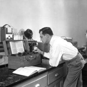 Dr. William C. Hackler in Ceramic Engineering graduate laboratory