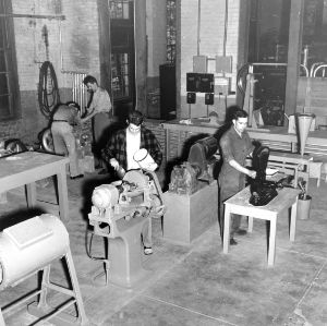 Ceramics laboratory - Ceramic Engineering Dept. : a section of the ceramics laboratories showing a group of students at work weighing, mixing, and grinding a batch of ceramic material, undated