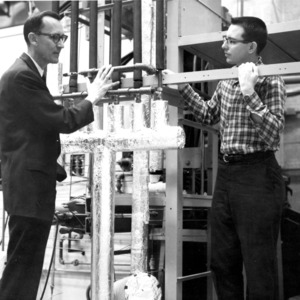 Dr. James K. Ferrell and John W. McGee inspecting heat exchanger of flow loop