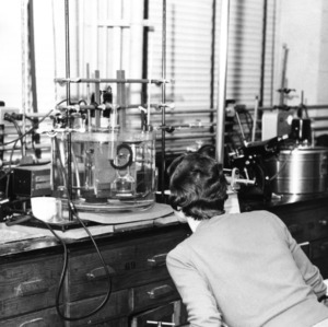 Mrs. Katherine Sphyalski measuring surface tension of liquids using capillary height technique, AIChE project, 1956 Dec.