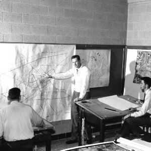 Herbert Wyndham and students studying transportation