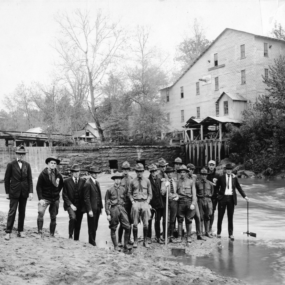 Class in hydraulics, Dept. of Civil Engineering, preparing to measure horsepower of stream, N.C. State College, Raleigh, N.C., 1920s?