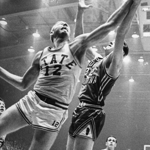 #12 blocks a shot by UNC-Chapel Hill's #32, 1963