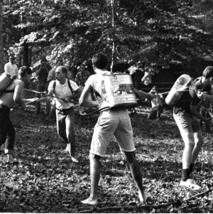 Students engaging in a water fight, 1950s?