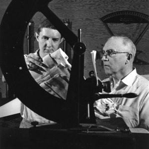 Professor and student examining material made of some heavy fiber, 1955 October.