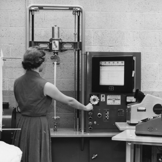 Ruth Guion, faculty member with Quality Audit Program at the North Carolina State College School of Textiles in testing lab, 1960.