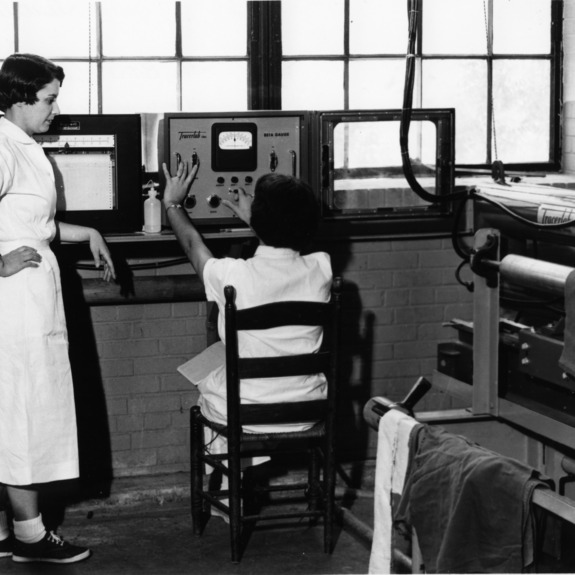Lila Kiser and assistant operating Beta Gauge in Textiles laboratory