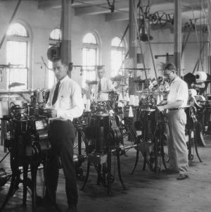 Textiles students operating hosiery machines in Tompkins Hall