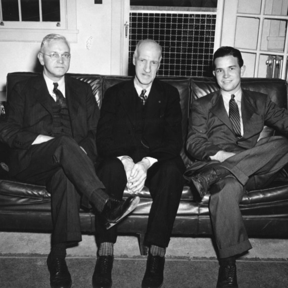 Dean Thomas Nelson of the North Carolina State College School of Textiles with two unidentified men.