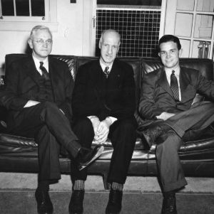 Dean Thomas Nelson on couch with two others