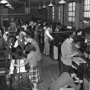 View of weave room at the School of Textiles, North Carolina State College, showing students and teachers operating looms, ca. 1945.