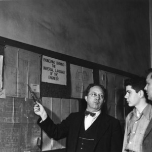 Group examining Mechanical Engineering department bulletin board