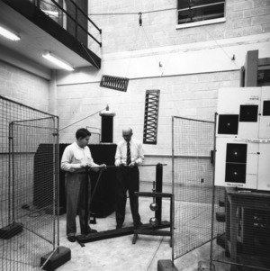 Dr. Wilhelm F. Gauster and other performing a rod-gap experiment in the High Voltage Laboratory